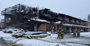 Firefighters put out the smoldering blaze at Royal Suites Lodge in midtown Anchorage on Feb. 15, 2017. (Photo by Anne Hillman/Alaska Public Media)