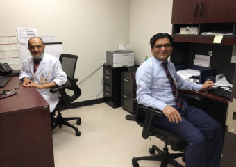 Dr. Farooq Habib (left) and Dr. Muhammad Tauseef share an office at Los Barrios Unidos Community Clinic in Dallas. They're both from Pakistan and have both worked as pediatricians in medically underserved areas in the U.S. Lauren Silverman/KERA