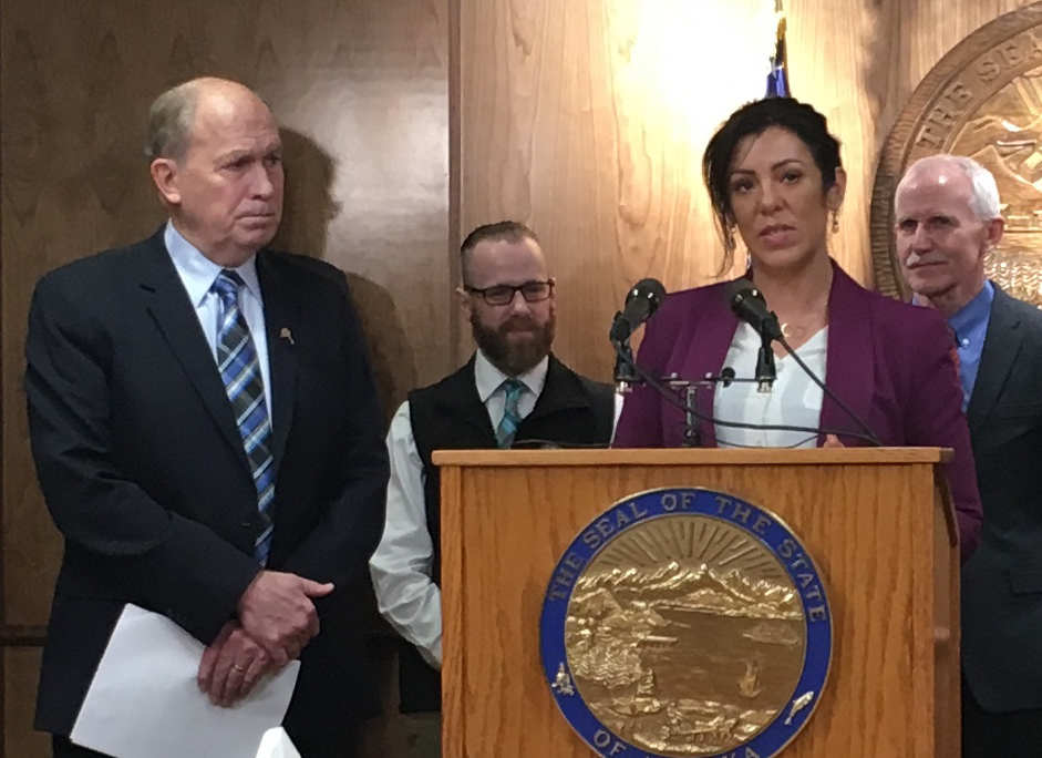 Gov. Bill Walker, state Emergency Programs Section Chief Andy Jones, Kara Nelson and state Chief Medical Officer Dr. Jay Butler during the Feb. 16 announcement of Walker's order on opioid addiction. (Photo by Andrew Kitchenman/Alaska Public Media/KTOO)