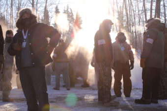 Fairbanks volunteers prepare for race start on banks of Chena River (Photo by Ben Matheson/KNOM)
