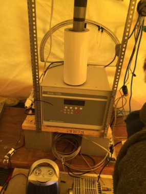 The beta attenuation monitor, or BAM, sits inside a heated tent. The unit draws in outside air through a stack that extends through the tent ceiling.