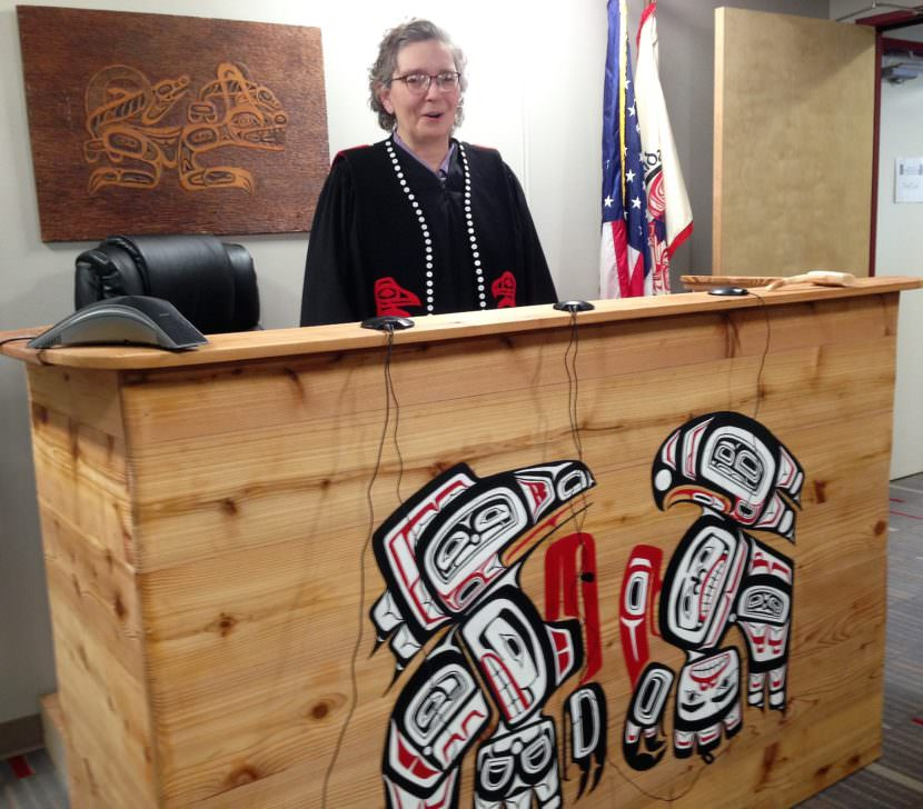 Presiding Judge Debra O'Gara stands in the Juneau courtroom of the Central Council of Tlingit and Haida Indian Tribes of Alaska. (Photo by Ed Schoenfeld/CoastAlaska News)
