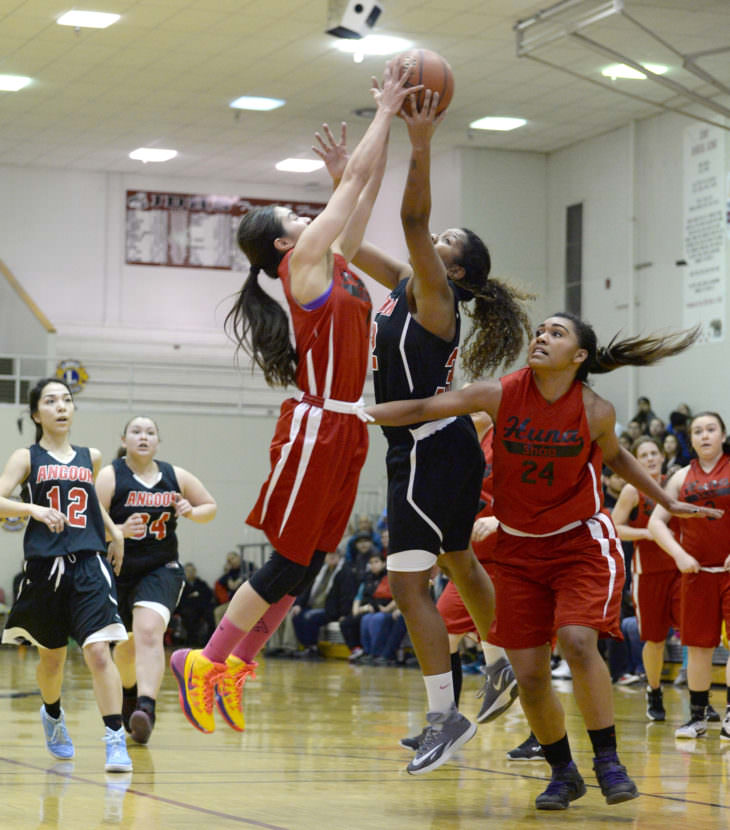 Hoonah's Melissa Fisher and Taryn White (24) challenge a shot by Angoon's Tasha McCoy during their elimination game in the 2015 Juneau Lions Club Gold Medal Basketball Tournament.