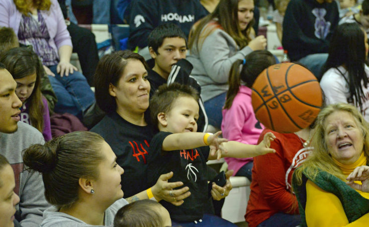 Basketball fan Kamari Lafferty, 2, returns a ball into play during the 69th Annual Gold Medal Basketball Tournament. (Photo courtesy Klas Stolpe)