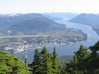 The Alaska Mental Health Trust owns land on the hillside south of Petersburg, near the top right of this photo. (KFSK file photo)