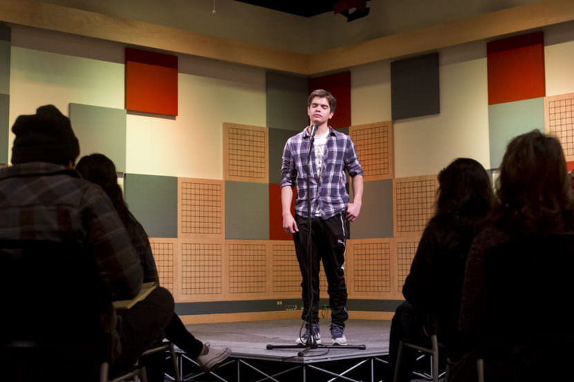"Homer High School student Juan Sarmiento performs ""every single day"" by John Straley during rehearsal for the Alaska state Poetry Out Loud finals in Juneau. (Photo by Annie Bartholomew/KTOO)"