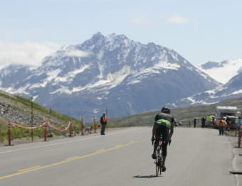A solo rider crests the summit during the 2016 Kluane-Chilkat International Bike Relay. (Photo by Jillian Rogers/KHNS)