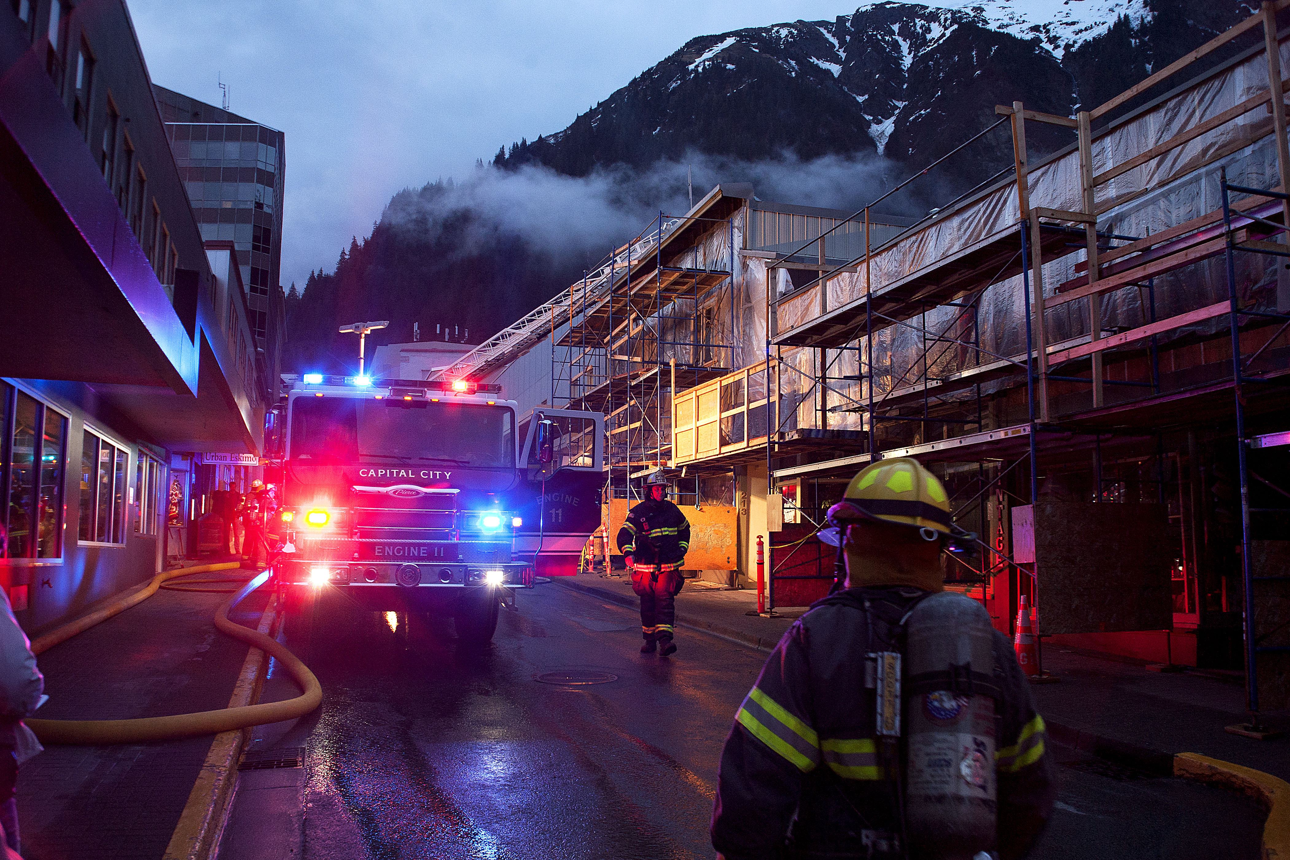Firefighters and emergency personnel work the scene of a possible fire Saturday night, April 15, 2017, in the 200 block of Seward Street, downtown Juneau. (Photo courtesy of Tripp J Crouse)