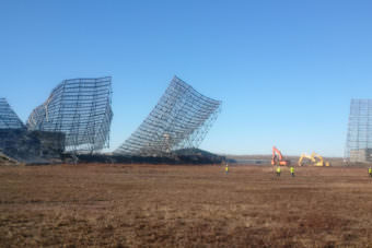 Workers pull down old radar structures that were part of the now-defunct Ballistic Missile Early Warning System at Clear Air Force Station in October. The Cold War-era BMEWS was removed and recycled to make way for new construction. About a billion dollars' worth of work is under way at Clear, related to installation of the a new radar system that will provide much greater coverage for such missile-defense facilities as the base at Fort Greely. (U.S. Air Force Space Command)