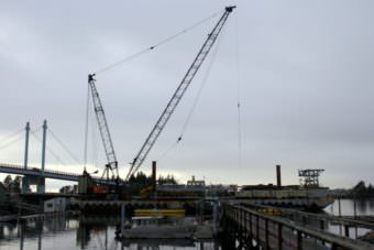 Turnagain's Brightwater barge and crane at work on the Petro Marine fuel dock last winter. The same equipment will be used to build the dock at the Gary Paxton Industrial Park — unless the court rules the contract illegal.