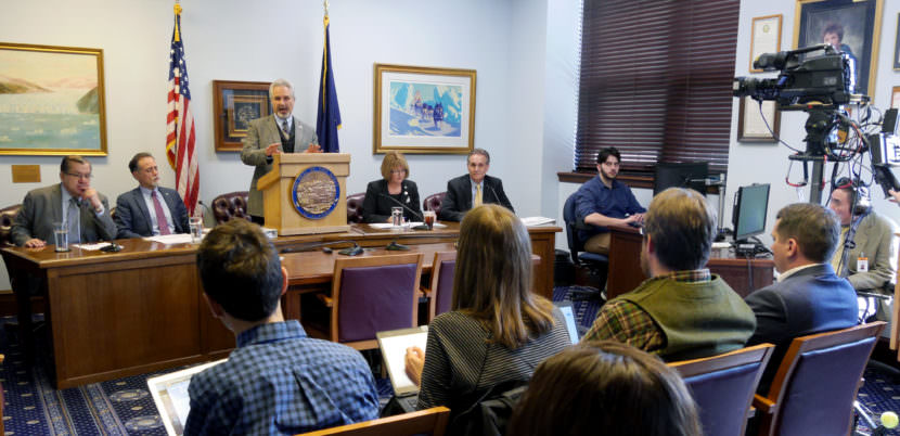 Senate President Pete Kelly, R-Fairbanks, talks to reporters at a Senate Majority press availability on Thursday. April 13, 2017, in Juneau. Sens. Lyman Hoffman, D-Bethel, Peter Micciche, R-Soldotna, Anna MacKinnon, R-Anchorage, and Kevin Meyer, R-Anchorage, seated left to right, also participated.
