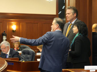 Majority Leader Peter Micciche, R- Soldotna, Sen. Mike Dunleavey, R-Wasilla, and Sen. Shelley Hughes, R-Palmer, (left to right) talk during an at-ease on the Senate Floor, April 6, 2017. (Photo by Skip Gray/360 North)