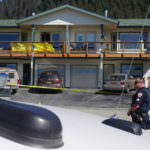 Juneau police Sgt. Chris Gifford keeps watch at a possible crime scene on Abby Court, where a 44-year-old Juneau woman was found dead