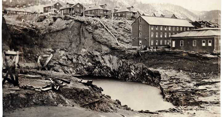 In this photo taken April 22, 1917, shows a massive sinkhole that opened up as the Treadwell Mines collapsed and filled with seawater.
