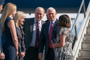 Vice President Mike Pence met with Alaska Gov. Bill Walker on Saturday, April 15, 2017, in Anchorage during a refueling stop.