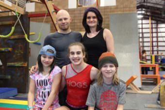 The Kronos gym is a family affair. Cody Johnston owns it with his wife, Tara. Their three children, Riley, 15, and 12-year-old twins Chase and Preslie, help with classes. (Photo Emily Kwong/KCAW)