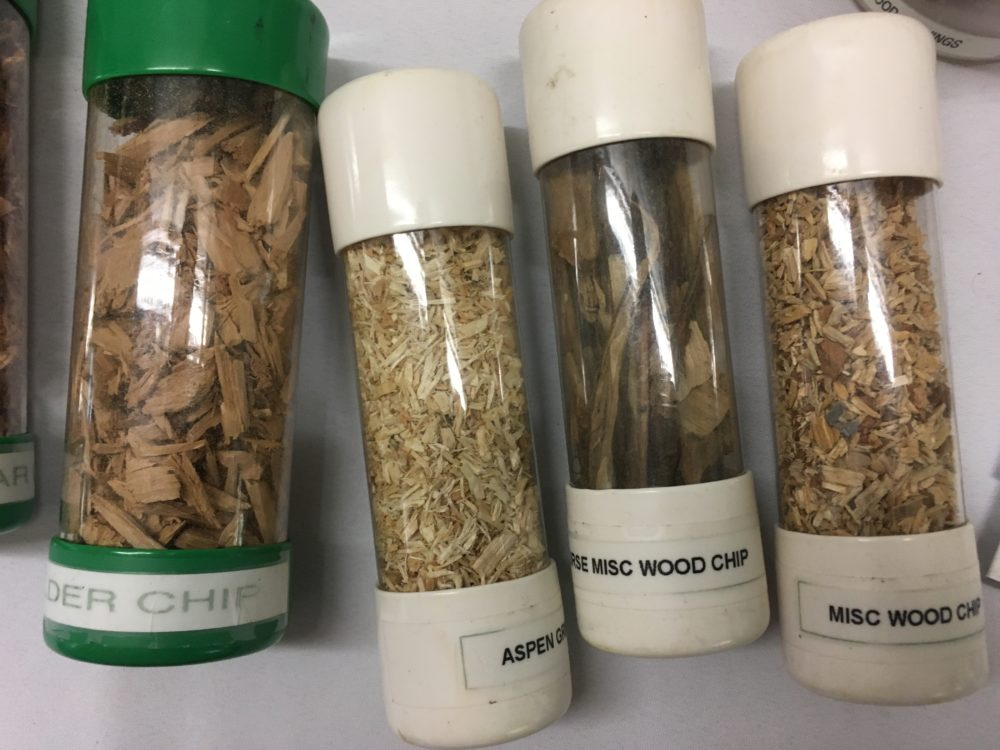Different wood chips are displayed at the 2017 Alaska Wood Energy Conference at Ketchikan's Ted Ferry Civic Center. (Photo by Leila Kheiry/KRBD)