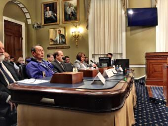 Witnesses wait to testify at a hearing in the U.S. House on the King Cove Road. (Photo by Liz Ruskin/Alaska Public Media)