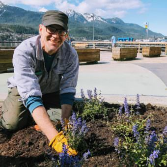"""This is the part I like. I like planting stuff, tending the flowers, the field work, being outside in all weather,"" said Ben Patterson, CBJ Landscape Maintenance Supervisor who also manages a 10-person seasonal crew. ""You can look back at the end of the day, see what's been planted and you can see people enjoying it. It's a little more rewarding than the office half of the job. The greenhouse is also really fun. We do about 16,000 annuals every year that grow from seed that we put all around town in 33 different spots."""