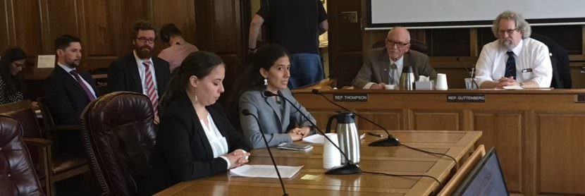 Natasha Singh (seated, right) said Tanana Chiefs Conference supports an income tax. She spoke to the House Finance Committee, with her sister Grace Singh (left), May 2, 2017. (Photo by Andrew Kitchenman/KTOO and Alaska Public Media)