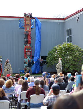 One of two new totem poles is unveiled at the Macaulay Salmon Hatchery on May 6, 2017.