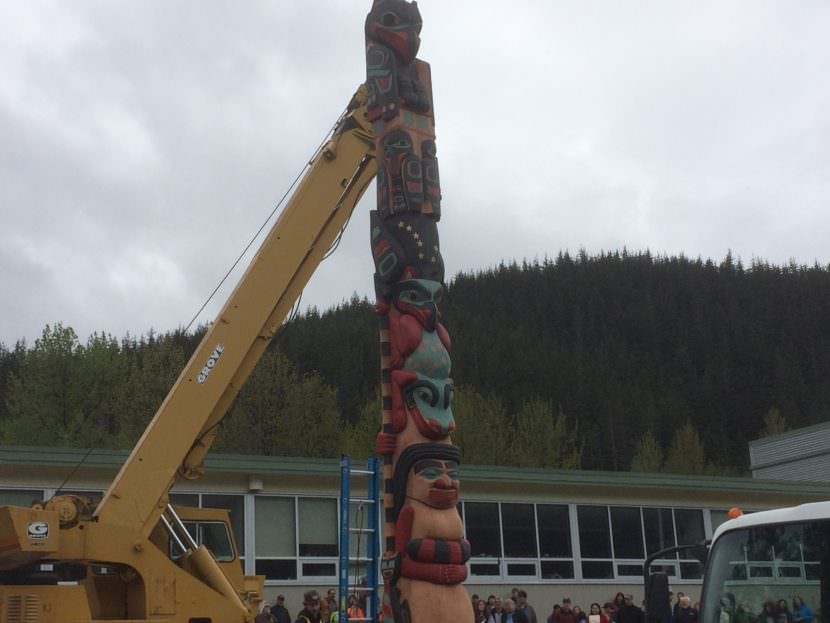 The Raven totem pole after being placed on its base on Saturday.