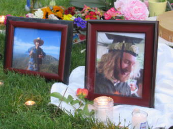 Mourners lit candles and incense and laid flowers before photos of Taliesin Myrddin Namkai Meche of Ashland, Oregon. Namkai Meche died Friday while trying to defend some young women on a train in Portland.