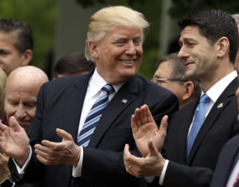 President Donald Trump celebrates with House Speaker Paul Ryan in the White House Rose Garden Thursday after the House voted to pass the American Health Care Act.