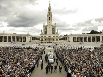 Hundreds of thousands of pilgrims gathered in Fatima, Portugal Saturday, where Pope Francis canonized two new saints. Jacinta and Francisco Marto were children 100 years ago when their visions of the Virgin Mary marked this place as an important Catholic shrine.