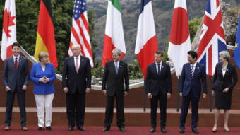 From left, Canadian Prime Minister Justin Trudeau, German Chancellor Angela Merkel, U.S. President Donald Trump, Italian Prime Minister Paolo Gentiloni, French President Emmanuel Macron, Japan's Prime Minister Shinzo Abe, and British Prime Minister Theresa May pose during the G7 summit in Taormina, Italy, on Friday.