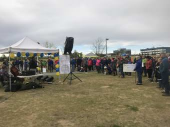 More than 100 people gathered in Anchorage's Cuddy Midtown Park on Saturday, May 20, 2017 to urge lawmakers to preserve education funding. (Photo by Josh Edge/Alaska Public Media)