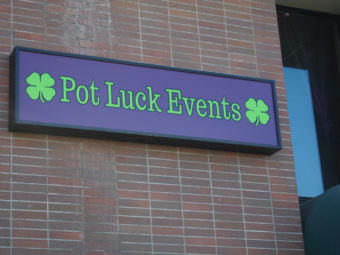 The sign outside Pot Luck Events, located at 420 W. 3rd Avenue in downtown Anchorage. (Photo by Zachariah Hughes/Alaska Public Media)