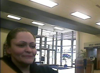 Anchorage Police Department are looking for this woman, who they believe is about 30-years-old, who is suspected in the robbery of an Alaska USA Federal Credit Union in Anchorage. (Video capture image courtesy Anchorage Police Department)