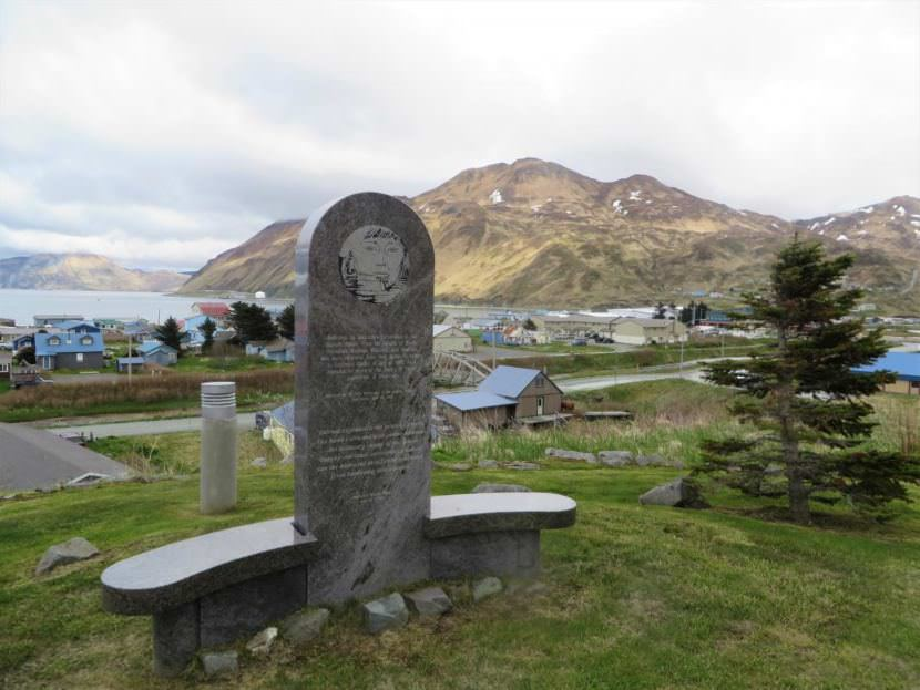 A memorial overlooks downtown Unalaska. It's dedicated to the Unangax who were forcibly evacuated during World War II and the Aleutian villages that were never resettled.
