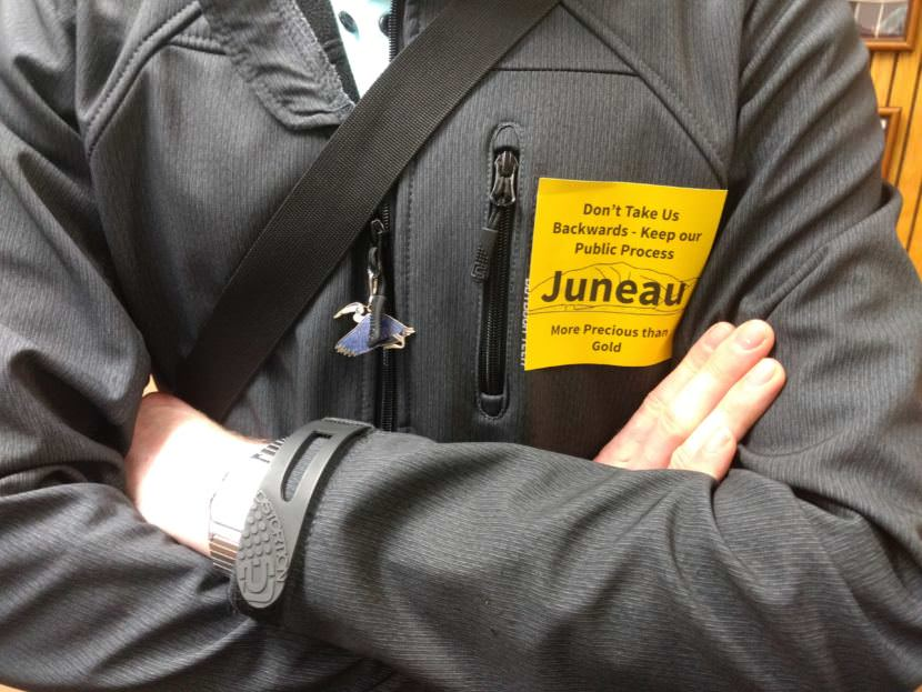 Residents against changing the city's mining ordinance wore yellow stickers to express their opposition at the June 12 Juneau Assembly meeting.