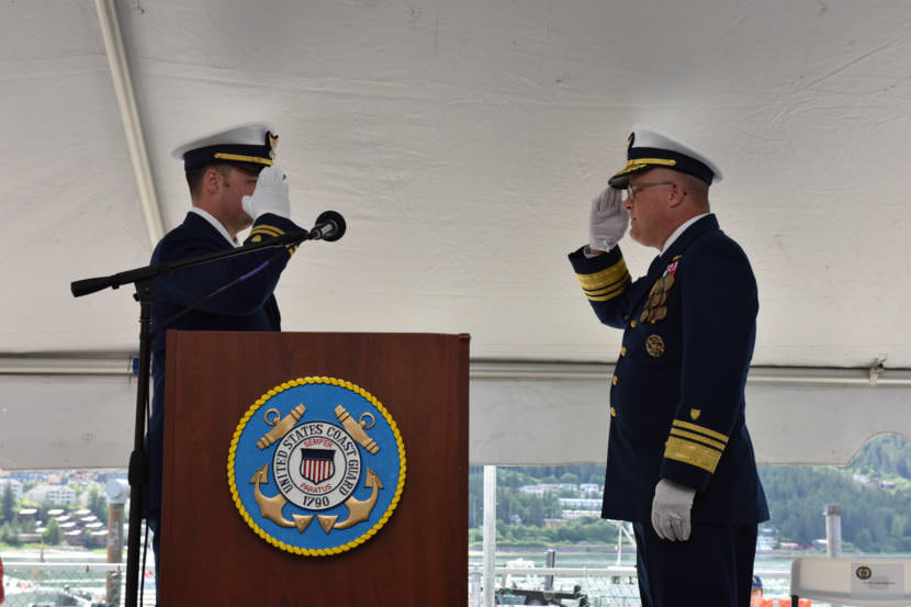Lt. Frank Reed, commanding officer of the Coast Guard cutter Bailey Barco, salutes Vice Adm. Fred Midgette, Coast Guard Pacific Area commander, as the vessel is officially commissioned into the Coast Guard during a ceremony in Juneau on June 14, 2017.