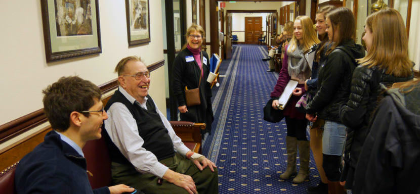 Former Sen. Clem Tillion, an Alaska state legislator from 1963 to 1980 and Senate President in 1979 and 1980, shares a moment with eighth grade students from Juneau's Dzantik'I Heeni middle school on Jan. 25, 2016. (Photo by Skip Gray/360 North)