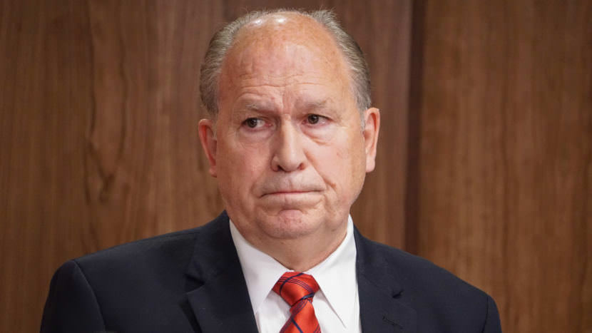 Alaska Gov. Bill Walker listens as Department of Revenue Commissioner Randall Hoffbeck discusses a compromise budget proposal with reporters in the cabinet room of the Capitol in Juneau on June 6, 2017. (Photo by Jeremy Hsieh/KTOO)