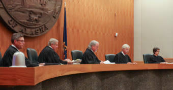 The Alaska Supreme Court hears arguments in the Boney Courthouse in Anchorage on June 20, 2017, in a case that seeks to overturn Gov. Bill Walker's veto of about half of Alaska Permanent Fund dividend money last year. Pictured from left to right: Justices Joel Bolger, Daniel Winfree, Craig Stowers, Peter Maassen and Susan Carney.