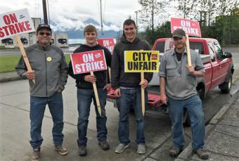 International Brotherhood of Electrical Workers representative Julius Matthew walked the picket line with Wrangell municipal workers Lorne Cook, Dwight Yancey and Andrew Scambler before the strike ended. (Photo courtesy IBEW)