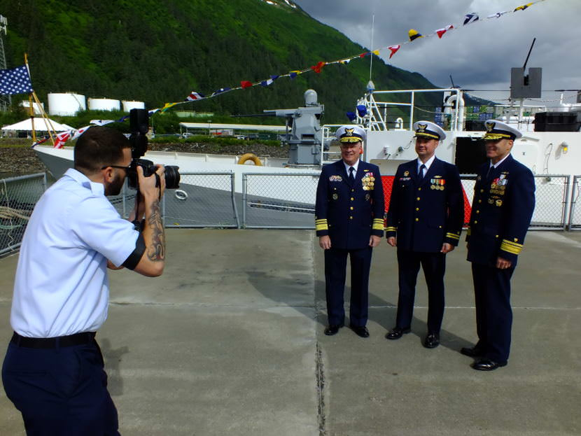 Vice Adm. Fred Midgette, commander of the Coast Guard's Pacific area (far left in group), Lt. Frank Reed, commanding officer of the cutter Bailey Barco (center), and Rear Adm. Michael McAllister, commander of the Coast Guard's 17th District (right) get their picture taken after a commissioning ceremony in Juneau on June 14, 2017.