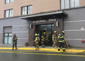 Firefighters respond to reports of smoke at the Mendenhall Tower Apartments in downtown Juneau on Monday, June 19, 2017. Officials had evacuated the building as a precaution, but couldn't find what caused the smoke.