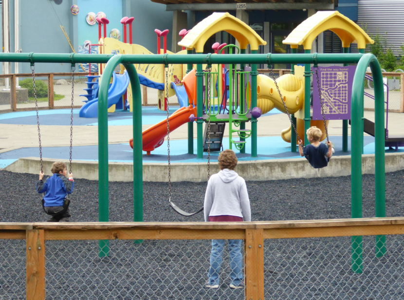 Juneau kids play on the playground in front of Harborview Elementary School on Wednesday.