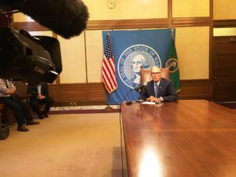 """Washington Gov. Jay Inslee speaks with reporters Tuesday after a bill signing. At the time there was no budget agreement and he said that was creating """"considerable anxiety"""" as a government shutdown loomed. (Photo by Austin Jenkins/Northwest News Network)"""