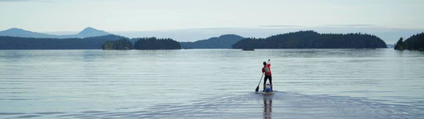 Karl Kruger paddles north through the Canadian Gulf Islands on June 12. (Photo courtesy Race to Alaska)