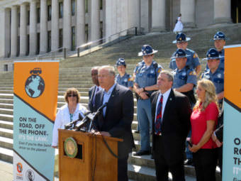 Washington Gov. Jay Inslee discusses a new distracted driving law on the state Capitol steps Monday, July 17, 2017.