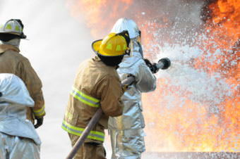 U.S. Air Force and New Jersey state fire protection specialists from the New Jersey Air National Guard's 177th Fighter Wing battle a simulated aircraft fire with Aqueous Film Forming Foam at Military Sealift Command Training Center East in Freehold, N.J. on June 12. Firefighters can spray the foam across the fire blanketing it so the oxygen is cut off and the fire is smothered. Airmen from the Wing hold annual training here to maintain mission readiness. (U.S. Air National Guard photo by Airman 1st Class Amber Powell/Released)