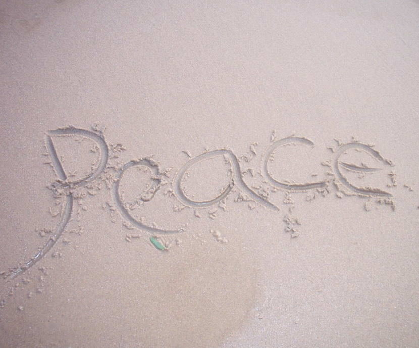 Peace written in sand.