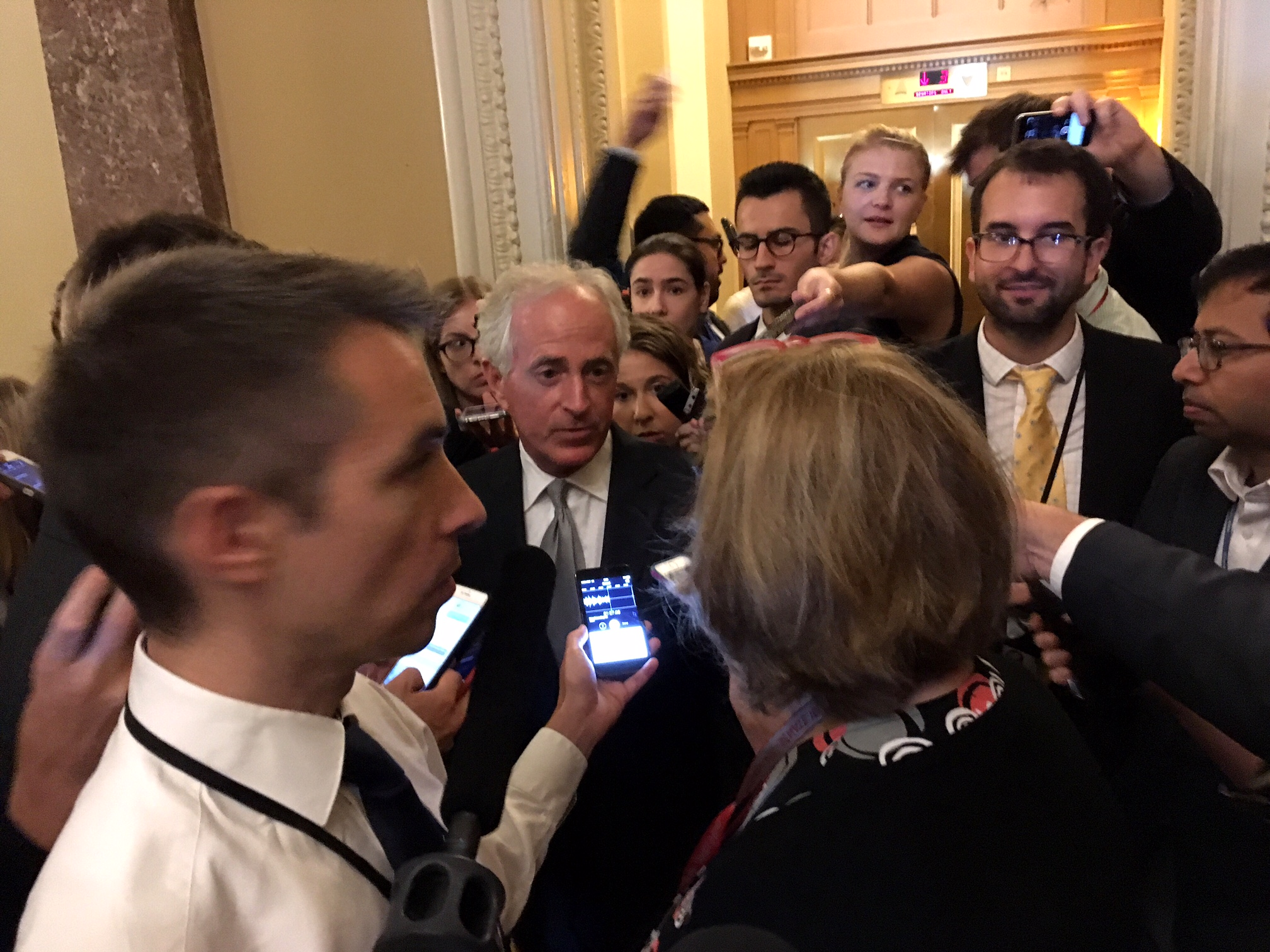 U.S. Sen. Bob Corker, R-Tennessee, at the center of one media scrum outside the Senate chamber. (Photo by Liz Ruskin/Alaska Public Media)