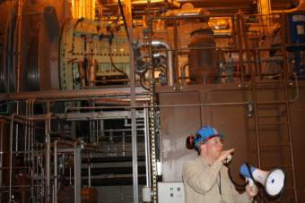 Plant Superintendent Nat Lewis shows off one of Plant 2A's new turbines.